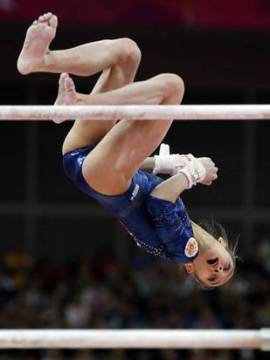 Victoria Kornova dismounts from uneven bars. Vernon Bryant/Photographer